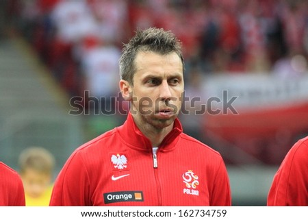 WARSAW - SEPTEMBER 6: Jakub Wawrzyniak (Poland) before the 2014 World Cup qualification match between Poland and Montenegro at the National Stadium on September 6, 2013 in Warsaw, Poland.  - stock photo