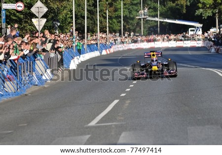 "WARSAW - SEPTEMBER 04: Mark Webber, Red Bull F1 driver, give a demonstration in his car along the streets of Warsaw in Running Showcar- ""Red Bull"" As w Karcie on September 04, 2010 in Warsaw, Poland"