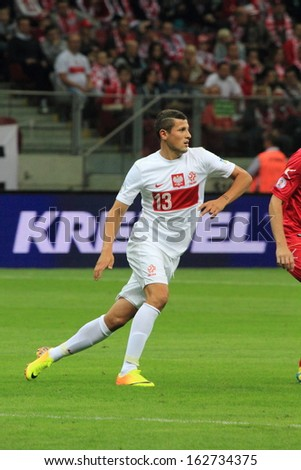 WARSAW - SEPTEMBER 6: Pawel Wszolek (Poland) during the 2014 World Cup qualification match between Poland and Montenegro at the National Stadium on September 6, 2013 in Warsaw, Poland.  - stock photo