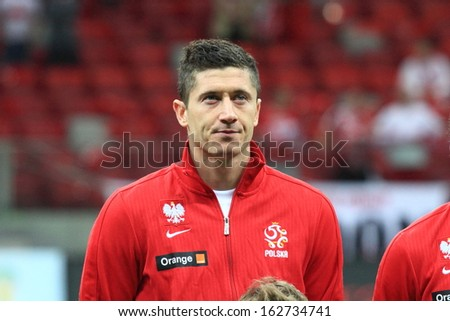 WARSAW - SEPTEMBER 6: Robert Lewandowski (Poland) before the 2014 World Cup qualification match between Poland and Montenegro at the National Stadium on September 6, 2013 in Warsaw, Poland.  - stock photo