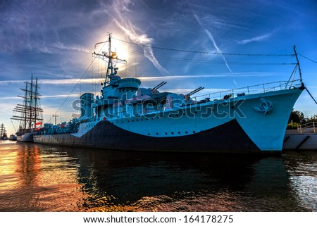 Warship in the port of dramatic scenery. Gdynia, Poland. - stock photo