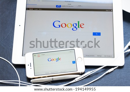 WARSZAWA, POLAND - APRIL 17, 2014. Google search page on screen of ipad and Iphone 5s.  In December 2013 Alexa listed google.com as the most visited website in the world - stock photo
