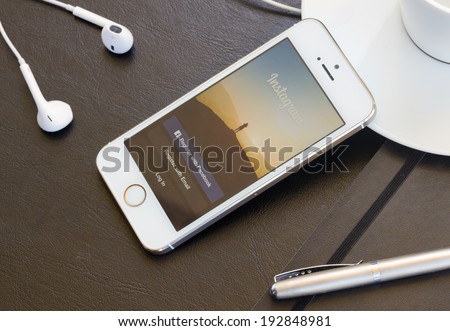 WARSZAWA, POLAND - APRIL 01, 2014: Instagram page on new iphone 5s. The photo-sharing social network, which has  150 million monthly active users - stock photo
