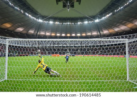 WARSZAWA, POLAND - MAY 02, 2014: Jorge Kadu shotting penalty kick to goalkeeper Silvio Rodic during the Polish Cup Final Zawisza Bydgoszcz - KGHM Zaglebie Lubin 6:5 (0:0). - stock photo