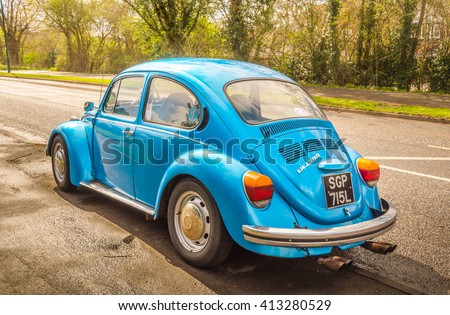 Warwickshire, United Kingdom - April 7, 2016: Blue classic car Volkswagen Beetle parked at the street as seen from the rear. - stock photo