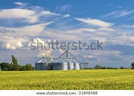 Was built metal agricultural silo the afield. - stock photo
