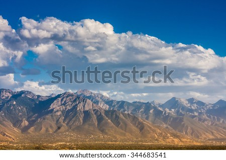 Wasatch Mountains range as viewed from Salt Lake City hills, Utah (United States). - stock photo