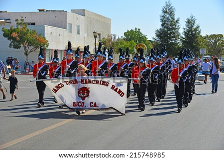 WASCO, CA - SEPTEMBER 6, 2014: The Wasco Tiger marching band leads the Festival of Roses parade.  This area in California's Central Valley produces 55% of all roses grown in the United States