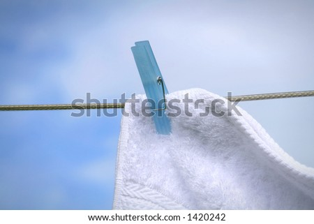 Wash day/Fluffy towel hanging with clothespin on the line - stock photo