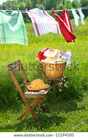 Wash day for dish towels on a summer day - stock photo