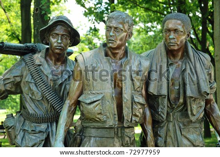 WASH DC - CIRCA JUNE 09: Sculptures of Vietnam War Veterans Memorial circa June 09 in Washington DC, USA. The Memorial receives around 3 million visitors each year. - stock photo