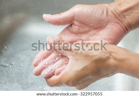 Wash hands with Hand washing gel - stock photo