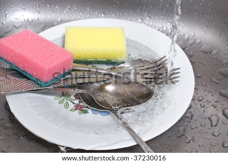 wash the dishes - stock photo