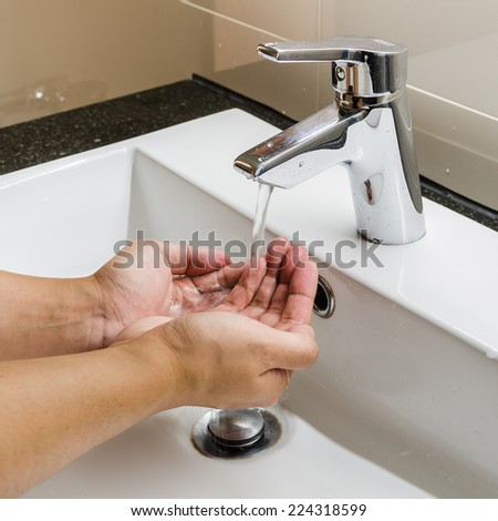 washbasin and faucet with hand washing - stock photo