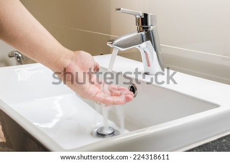 washbasin and faucet with hand washing at home - stock photo