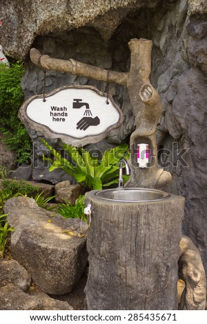 Washbasin in one of the parks in Phuket, Thailand - stock photo