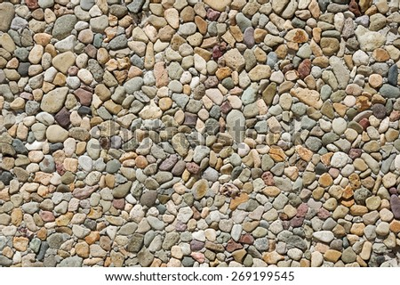 washed pebble concrete wall background texture - stock photo