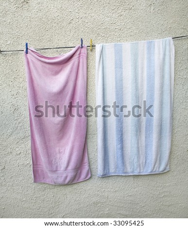 Washed Towel drying in the sun - stock photo