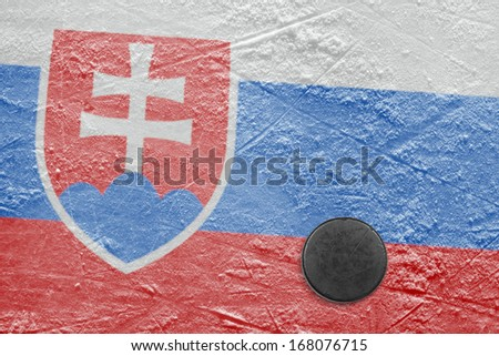 Washer and the image of the flag of Slovakia at hockey rink - stock photo