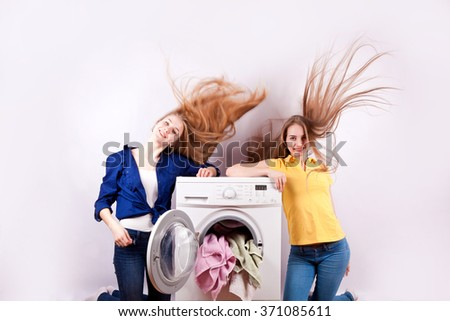 Washer and young girls isolated on white background