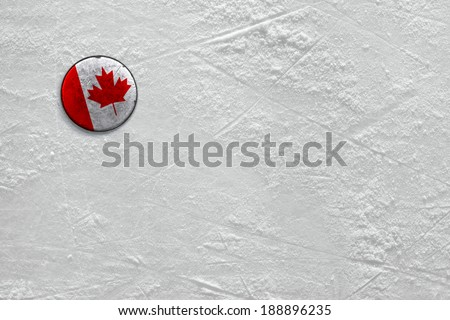 Washer with the image of the Canadian flag on a hockey rink - stock photo