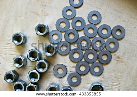 Washers and Nuts on Wooden Board