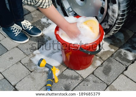 washing a car by hand - stock photo