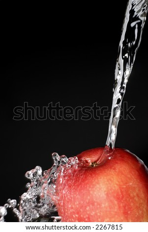 washing an apple - stock photo
