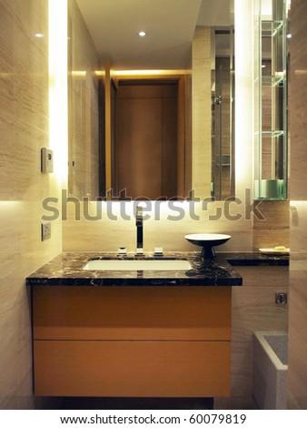 Washing basin and mirror in bathroom - stock photo