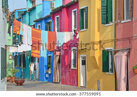 Washing day on the colourful island of Burano in the Venice lagoon. - stock photo