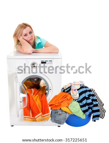 Washing dirty linen on the washing machine. Beautiful girl washes clothes. Isolation. A series of images.