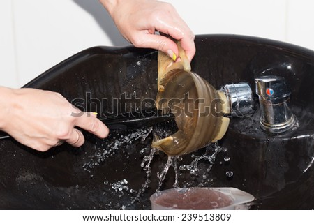 washing dishes in water - stock photo