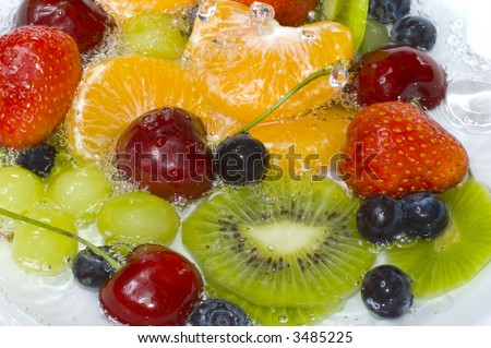 Washing fruits in fresh water, macro image