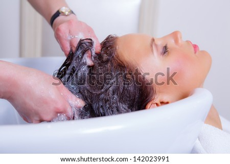 Washing hair in barbershop - stock photo