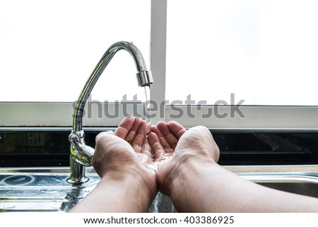 Washing hand in kitchen - stock photo