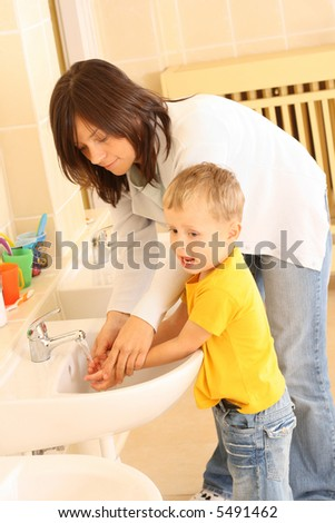 washing hands in preschool - teacher and 3-4 years old preschooler