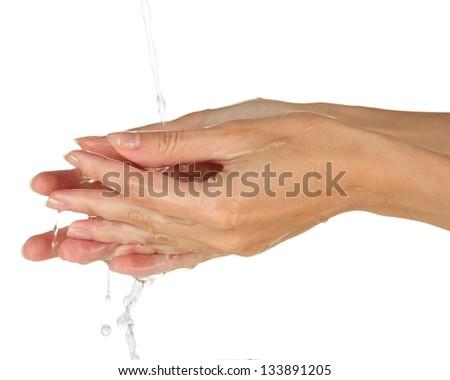 Washing hands on white background close-up - stock photo