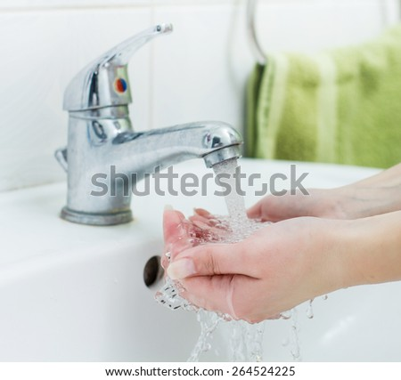 Washing Hands with streaming water in bathroom. Hygiene  - stock photo
