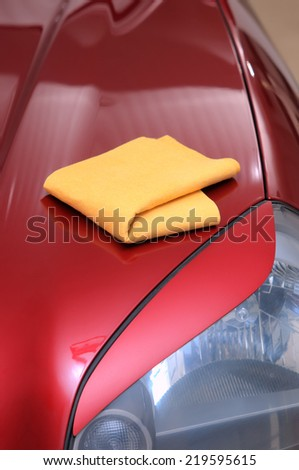 washing his car with a wet cloth - stock photo