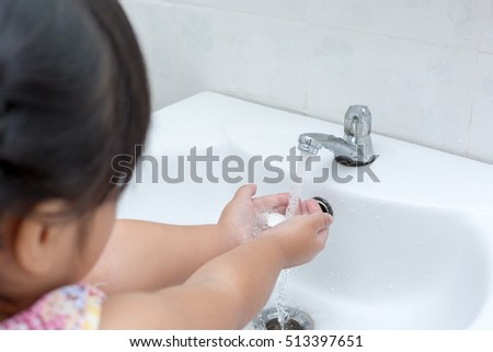 Washing kid hands,Hygiene. Cleaning Hands,Kid washing of hands with soap under running water.