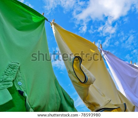 Washing line laundry on a bright summer day - stock photo