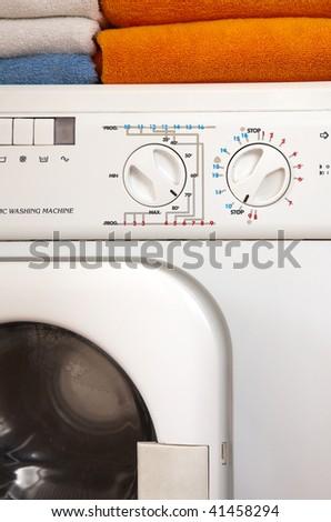 washing machine and towels in bathroom - stock photo