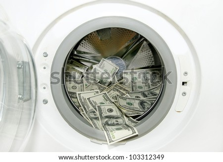 washing machine and wash paper dollars dollars - stock photo