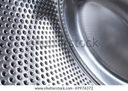 washing machine drum background with copyspace showing household concept