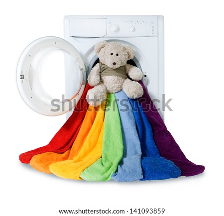 Washing machine, toy and colorful things to wash, isolated - stock photo