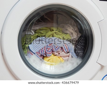 Washing machine with clothes .