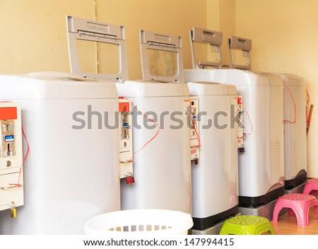 Washing machines coin - stock photo