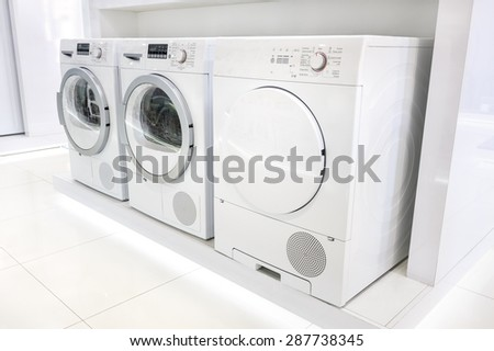 Washing machines, dryer and other domestic appliance equipment in the store - stock photo