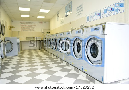 Washing machines in a laundry - stock photo