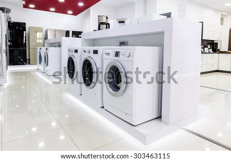 Washing machines, refrigerators and other home related appliance or equipment in the retail store - stock photo
